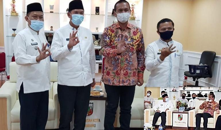 Wako Pariaman Genius Umar saat mengunjungi Wako Pekanbaru, Firdaus untuk penjajakan kerjasama investasi pengembangan sektor pariwisata, Jumat (15/1). (Dok : Istimewa)