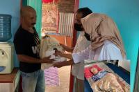 Andre Bantu Lansia yang Sakit Stroke di Nanggalo